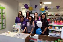The team at Well Pharmacy in Paisley, Scotland promoting the multiple's chosen charity partner
