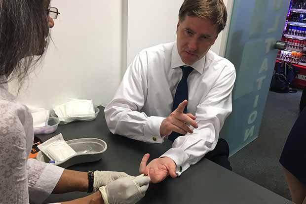 Steve Brine had a mock blood test for hepatitis C in Portmans Pharmacy, London