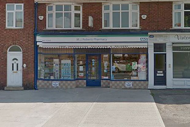 A piece of concrete was thrown through the window of MJ Roberts Pharmacy in York. Credit: © 2017 Google, image capture: June 2016.