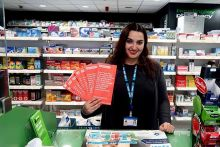 Pharmacist Veronica Sanna and the red bags in Headingly Pharmacy, Leeds