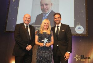 Caerphilly pharmacist Elin Hooper collects the C+D Award on behalf of Mayberry Pharmacy